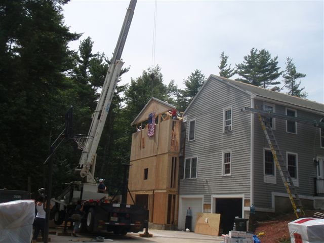 Crane lifting material into place at Bella Tuckers house.